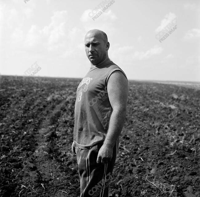 Vassily Volodin, tractor driver on the farm of the Resurrection near Mikhailov, Ryazan region. Russia, July 24, 2008.