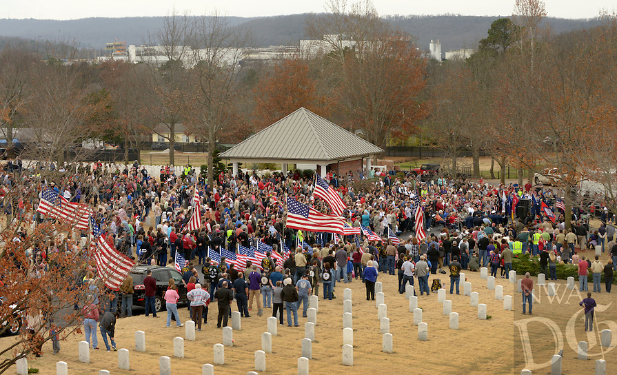 NWA Democrat-Gazette/BEN GOFF @NWABENGOFF<br /> A crowd gathers on Saturday Dec. 12, 2015 during the Wreaths Across America ceremony at Fayetteville National Cemetery. Family members and volunteers with various veterans and community groups helped place a balsam remembrance wreath on the grave of each veteran at the cemetery as part of National Wreaths Across America Day.