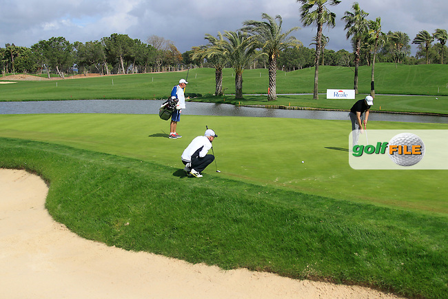 Simon Dyson (ENG) and Gregory Bourdy (FRA) on the 9th green during Saturday's rain delayed Round 3 of the Open de Espana at Real Club de Golf de Sevilla, Seville, Spain, 5th May 2012 (Photo Eoin Clarke/www.golffile.ie)