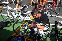 19 SEP 2010 - LA BAULE, FRA - A competitor prepares his bike before the start of the Triathlon Courte Distance during the 23rd Triathlon Audencia-La Baule (PHOTO (C) NIGEL FARROW)