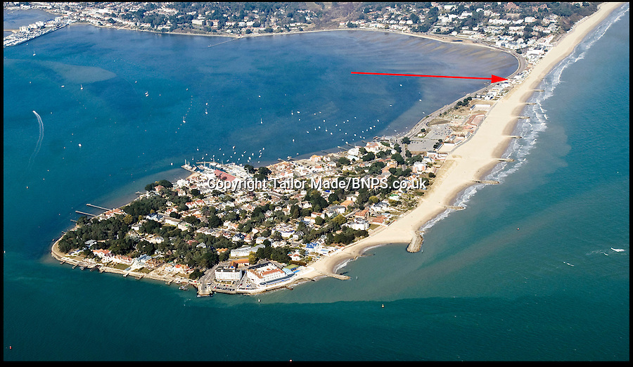 BNPS.co.uk (01202) 558833<br /> Picture: Adrian Dunford<br /> <br /> An arial view showing the house on the Sandbanks peninsular<br /> <br /> This run-down house in desperate need of repair has sold for nearly &pound;3.5million to set a record for the millionaire's resort of Sandbanks. The price paid for the shabby home on the sandy peninsular in Poole, Dorset, equates to &pound;1,725 per square foot. But the unnamed couple who have bought the pile are more interested in the two-way views of picturesque Poole Harbour from the front and the sea to the rear. The property is one of the last of its type on the exclusive peninsula that has yet to be bought up and developed.<br /> <br /> Sandbanks is rated at the fifth most expensive location in the world to buy property, with only Manhatten, Tokyo, Hong Kong and London ahead of it. Estate agents have described the deal as a 'sensible price'.