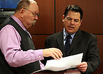 Legislative staff member Scott Young, left, talks with Nevada Sen. Michael Roberson, R-Las Vegas, before a hearing at the Legislature in Carson City, Nev. on Wednesday, March 2, 2011..Photo by Cathleen Allison