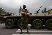 "A member of special pro-russian battalion ""Vostok"" seen during the military coup in DNR (Donetsk Peoples Republic), taking over town hall, held by another group of pro-russian activists."