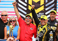 Sep 5, 2016; Clermont, IN, USA; NHRA top fuel driver Tony Schumacher (right) celebrates with father Don Schumacher (center) and mother Sarah Schumacher after winning the US Nationals at Lucas Oil Raceway. Mandatory Credit: Mark J. Rebilas-USA TODAY Sports