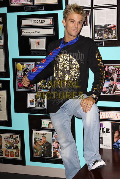 AARON CARTER, Dancing with the Stars.Celebrities Visits the Ed Hardy Outlets held At Ed Hardy Headquarters, Culver City, California, USA..September 30th, 2009.full length jeans denim black top gold print purple scarf.CAP/ADM/KB.©Kevan Brooks/AdMedia/Capital Pictures.