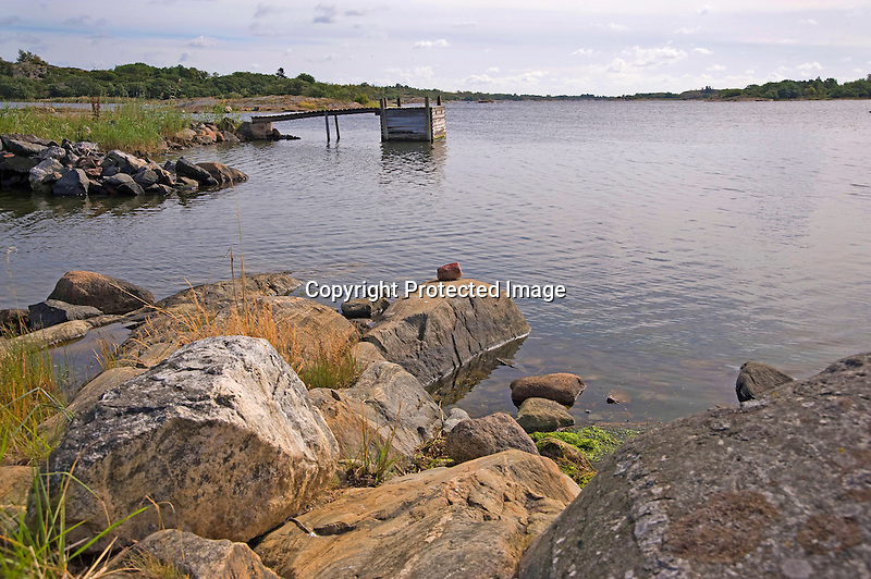 Rocky Shore and Dock in Quiet Cove on Island of Kökar