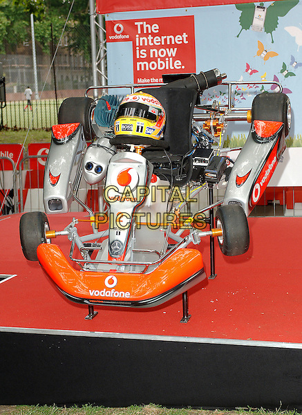 GO-KART.Photocall at a special event in Brunswick Square to launch Vodafone's UK Mobile Internet service. Hamilton was there to hand over his VodafoneMcLaren Mercedes Go-Kart to the winner of an Ebay auction. The kart was auctioned off for £42,000 in aid of Tommy's Childrens Charity. Unfortunately Lewis Hamilton managed to crash the go-kart damaging the rear axle before handing it over! .London England, 21st June 2007..full length car crash helmet race go kart cart.CAP/ BEL.©Tom Belcher/Capital Pictures.