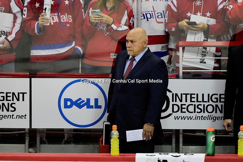 Friday, April 22, 2016: Washington Capitals head coach Barry Trotz watches as the team warms up before game 5 of the first round of the National Hockey League Eastern Conference playoffs  between the Philadelphia Flyers and the Washington Capitals held at the Verizon Center in Washington, DC. The Flyers defeat the Capitals 2-0. Eric Canha/CSM