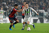 30th October 2019; Allianz Stadium, Turin, Italy; Serie A Football, Juventus versus Genoa; Cristian Romero of Genoa FC challenges Cristiano Ronaldo of Juventus - Editorial Use