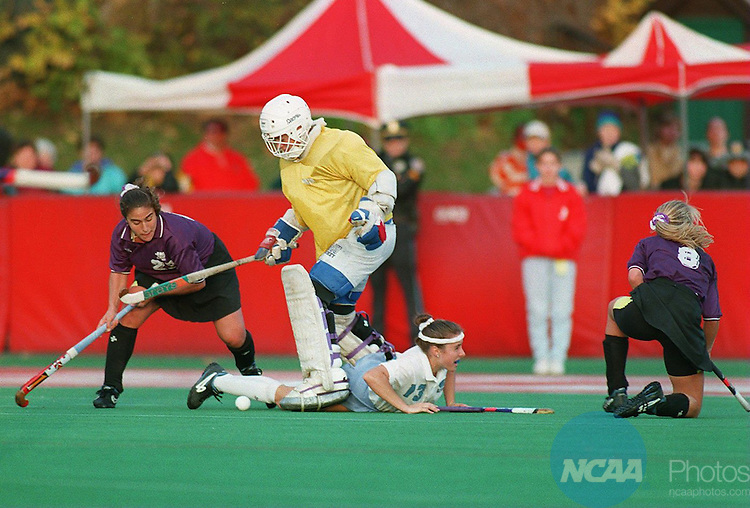 Caption: North Carolina's Jana Withrow ( goalie) stops a shot by James Madison's Renee Ranere (#23) at the Division I Field Hockey Championship November 20, 1994, in Boston, Massachusetts. James Madison won the game 2-1. Winslow Townson/NCAA Photos.