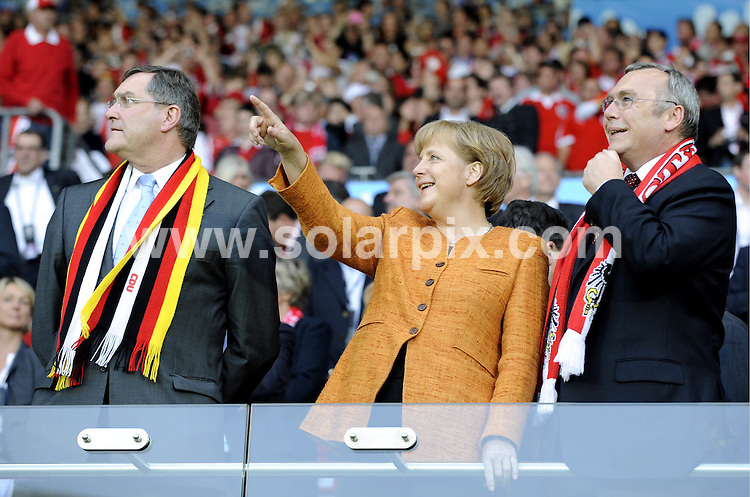 **ALL ROUND PICTURES FROM SOLARPIX.COM**.**SYNDICATION RIGHTS FOR UK AND SPAIN ONLY**.Football Euro European Championship 2008 Austria vs Switzerland the preliminary Group B, Match 20 in Austria  16 June 2008 at the Ernst Happel Stadium in Vienna Austria..Germany's chancelor Angela Merkel and Germany's foreign minister Frank-Walter Steinmeier CDU singing the national anthem. .This pic:Germany's chancelor Angela Merkel (C) and Germany's foreign minister Frank-Walter Steinmeier (CDU, front, 3rd L.JOB REF:6654-CPR/Torsten Silz        DATE:16_06_08.**MUST CREDIT SOLARPIX.COM OR DOUBLE FEE WILL BE CHARGED* *UNDER NO CIRCUMSTANCES IS THIS IMAGE TO BE REPRODUCED FOR ANY ONLINE EDITION WITHOUT PRIOR PERMISSION*