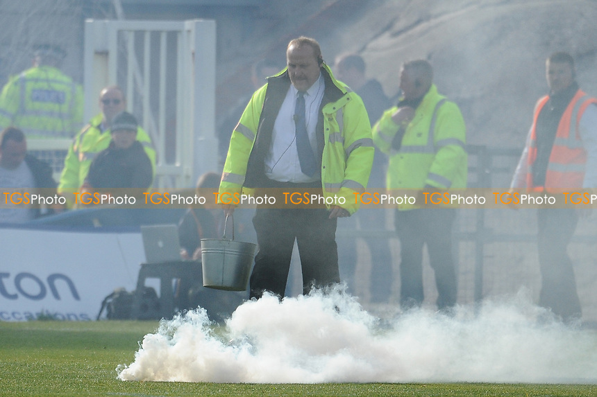 Hartlepool United fans throw a number of smoke bombs onto the pitch during Hartlepool United vs Doncaster Rovers, Sky Bet EFL League 2 Football at Victoria Park on 6th May 2017