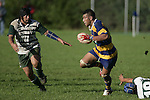 Jeff Maka steps out of one tackle and is noe confronted by M. Leota Counties Manukau Premier Club Rugby, Patumahoe vs Manurewa played at Patumahoe on Saturday 6th May 2006. Patumahoe won 20 - 5.