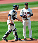 6 September 2009: Cleveland Indians' catcher Chris Gimenez gives pitcher David Huff encouragement during a game against the Minnesota Twins at Progressive Field in Cleveland, Ohio. The Indians defeated the Twins 3-1 to take the rubber match of their three-game weekend series. Mandatory Credit: Ed Wolfstein Photo