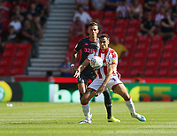 Stoke City's Lee Gregory shields the ball from Leeds United's Ben White<br /> <br /> Photographer Stephen White/CameraSport<br /> <br /> The Premier League - Stoke City v Leeds United - Saturday August 24th 2019 - bet365 Stadium - Stoke-on-Trent<br /> <br /> World Copyright © 2019 CameraSport. All rights reserved. 43 Linden Ave. Countesthorpe. Leicester. England. LE8 5PG - Tel: +44 (0) 116 277 4147 - admin@camerasport.com - www.camerasport.com