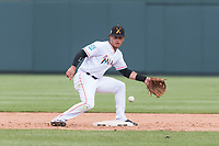 Salt River Rafters shortstop Bryson Brigman (15), of the Miami Marlins organization, covers second base on an attempted steal during an Arizona Fall League game against the Surprise Saguaros at Salt River Fields at Talking Stick on October 23, 2018 in Scottsdale, Arizona. Salt River defeated Surprise 7-5 . (Zachary Lucy/Four Seam Images)