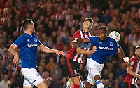 Lincoln City's Jason Shackell battles with Everton's Djibril Sidibe<br /> <br /> Photographer Andrew Vaughan/CameraSport<br /> <br /> The Carabao Cup Second Round - Lincoln City v Everton - Wednesday 28th August 2019 - Sincil Bank - Lincoln<br />  <br /> World Copyright © 2019 CameraSport. All rights reserved. 43 Linden Ave. Countesthorpe. Leicester. England. LE8 5PG - Tel: +44 (0) 116 277 4147 - admin@camerasport.com - www.camerasport.com