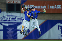 (L-R) Jimmy Herron (30), Kennie Taylor (15), and Griffin Conine (9) celebrate their win over the Clemson Tigers in Game Three of the 2017 ACC Baseball Championship at Louisville Slugger Field on May 23, 2017 in Louisville, Kentucky.  The Blue Devils defeated the Tigers 6-3.. (Brian Westerholt/Four Seam Images)
