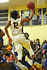 Danny Ashley #12 of Uniondale makes an acrobatic move to get off a shot during a non-league varsity boys basketball game against Copiague in the Richard Brown Nassau-Suffolk Challenge at Uniondale High School on Saturday, Jan. 13, 2018.