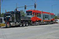 May 1, 2013  (Washington, DC)  A new streetcar arrives  at the DDOT Anacostia facility via flatbed truck May 1, 2013. The new cars are expected to enter service at the end of 2013. (Photo by Don Baxter/Media Images International)