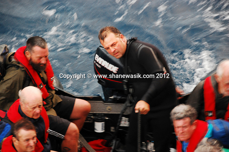Returning to the expedition boat following a land excursion during choppy conditions at Raoul Island, Kermadecs.