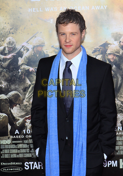 """ASHTON HOLMES .Attending the Los Angeles Premiere of HBO's """"The Pacific"""" held at Grauman's Chinese Theater, Hollywood, California, USA, 24th February 2010 .half length blue scarf suit tie navy suit  .CAP/ADM/TC.©T. Conrad/AdMedia/Capital Pictures."""