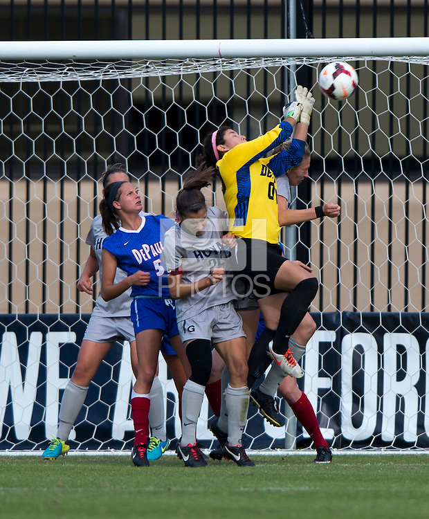 Alejandria Godinez (00) of DePaul punches the ball out of the box during the game at Shaw Field on the campus of Georgetown University in Washington, DC.  Georgetown tied DePaul, 1-1, in double overtime.
