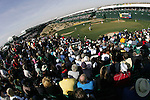 Phil Mickelson, Rickie Fowler, and Chris Couch putt on the most famous hole on the PGA tour the 16th, at the Waste Management Phoenix Open in Scottsdale, Arizona.