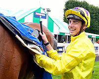 Jockey James Doyle unsaddles Sea of Faith in the Winner's enclosure after winning The British EBF Premier Fillies' Handicap during Horse Racing at Salisbury Racecourse on 15th August 2019