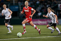 Caroline Seger (9) of the Western New York Flash, center, dribbles the ball against Meghan Klingenberg of the magicJack during second half action. The Western New York Flash defeated the magicJack 3-0 in Women's Professional Soccer (WPS) at Sahlen's Stadium in Rochester, NY May 22, 2011.3
