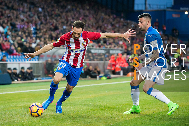 Juan Francisco Torres Belen, Juanfran (l), of Atletico de Madrid competes for the ball with Diego Rico of Deportivo Leganes during their La Liga match between Atletico de Madrid and Deportivo Leganes at the Vicente Calderón Stadium on 04 February 2017 in Madrid, Spain. Photo by Diego Gonzalez Souto / Power Sport Images