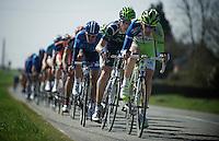 peloton speeding out of Cassel ..74th Gent-Wevelgem (2012).236km between Deinze & Wevelgem.winner 2012: Tom Boonen..