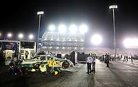 May 2, 2008; Richmond, VA, USA; NASCAR Nationwide Series driver Kenny Wallace sits in the garage as crew members make repairs during the Lipton Tea 250 at the Richmond International Raceway. Mandatory Credit: Mark J. Rebilas-US PRESSWIRE