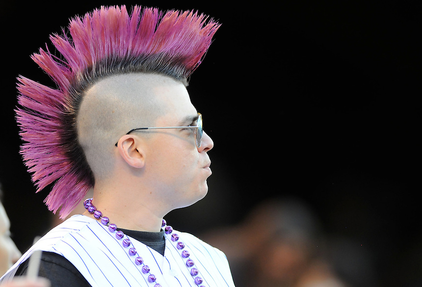 18 JULY 2011:  A colorful Colorado Rockies fan with a purple mohawk and reflective aviator sunglasses  during a regular season game between the Atlanta Braves and the Colorado Rockies at Coors Field in Denver, Colorado. The Braves beat the Rockies 7-4. *****For Editorial Use Only*****