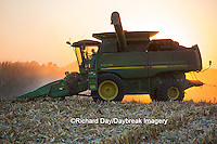 63801-06719 John Deere combine harvesting corn at sunset, Marion Co., IL