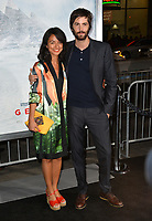 Jim Sturgess &amp; Dina Mousawi at the premiere for &quot;Geostorm&quot; at TCL Chinese Theatre, Hollywood. Los Angeles, USA 16 October  2017<br /> Picture: Paul Smith/Featureflash/SilverHub 0208 004 5359 sales@silverhubmedia.com