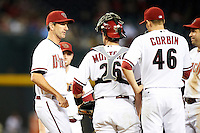 Arizona Diamondbacks pitching coach Charles Nagy #50 talks with pitcher Patrick Corbin #46, catcher Miguel Montero #26 during a National League regular season game against the Colorado Rockies at Chase Field on October 3, 2012 in Phoenix, Arizona. Arizona defeated Colorado 5-3. (Mike Janes/Four Seam Images)