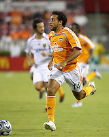 Houston Dynamo midfielder Dwayne De Rosario (14) advances the ball. The Houston Dynamo defeated Real Salt Lake 4-3 during an MLS regular season game at Robertson Stadium in Houston, TX on September 8, 2007.