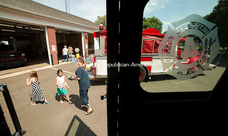 BETHLEHEM, CT--- -082915JS02- Katie LaPointe of Bethlehem, right, along with her daughter Raegan LaPointe, 6, center, and niece, Hazel Cole, 5, left, tours the Bethlehem Volunteer Fire Department's headquarters as the department celebrated their 75th anniversary on Saturday. <br /> Jim Shannon Republican-American