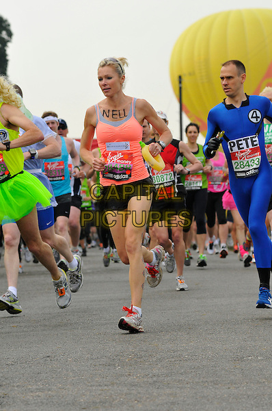 NELL McANDREW.Virgin London Marathon, Blackheath, London, England..April 17th, 2011.full length pink coral sleeveless vest top sneakers trainers black shorts exercise starting start line race run running jog jogging.CAP/CAS.©Bob Cass/Capital Pictures.