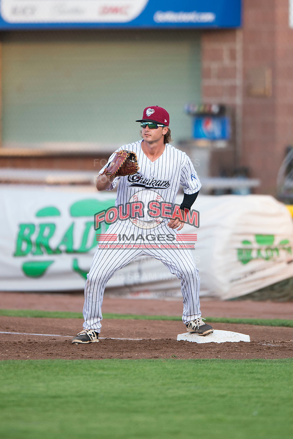 Idaho Falls Chukars first baseman Reed Rohlman (19) during a Pioneer League game against the Great Falls Voyagers at Melaleuca Field on August 18, 2018 in Idaho Falls, Idaho. The Idaho Falls Chukars defeated the Great Falls Voyagers by a score of 6-5. (Zachary Lucy/Four Seam Images)