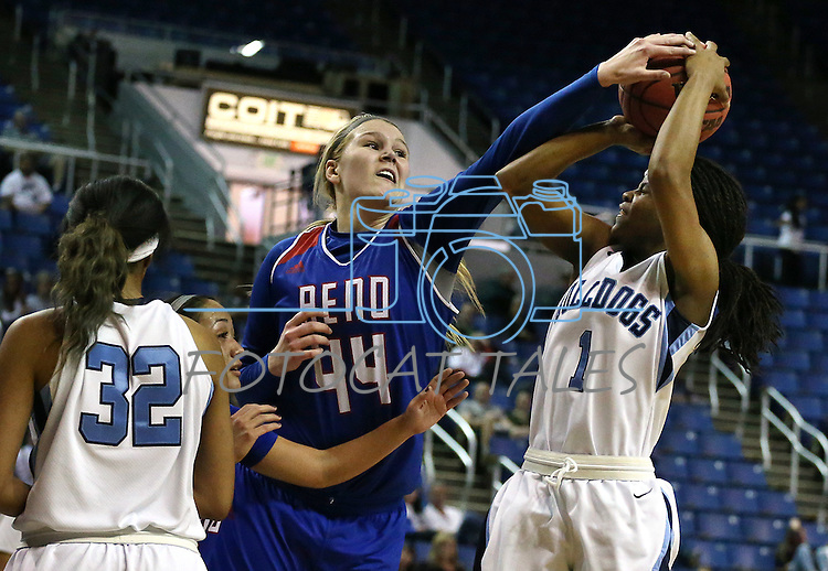 Reno's Mallory McGwire tries to block a shot by Centennial's Pam WIlmore during the NIAA Division I state basketball tournament in Reno, Nev. on Thursday, Feb. 25, 2016. Centennial won 83-53. Cathleen Allison/Las Vegas Review-Journal