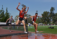 Apr 11, 2015; Los Angeles, CA, USA; Harrison Luft  (left) and Aaron Sugimoto of Occidental College race over the water jump in the steeplechase in a SCIAC multi dual meet at Occidental College. Luft placed third in 9:50.62 and Sugimoto was fourth in 9:52.68. Photo by Kirby Lee