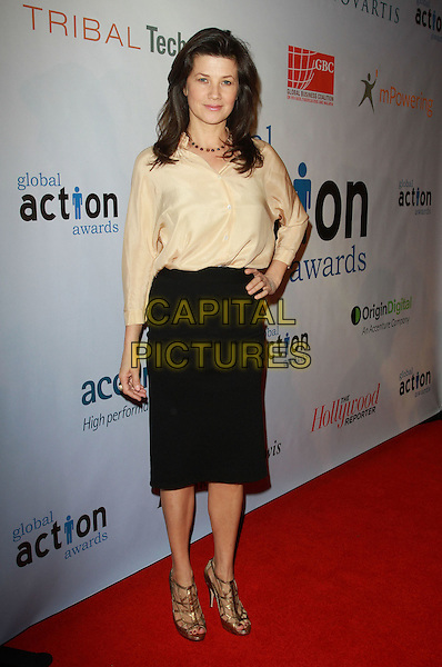DAPHNE ZUNIGA .First Annual Global Action Forum Gala Held At The Beverly Hilton Hotel, Beverly Hills, California, USA, .18th Febuary 2011..full length black skirt hand on hip cream top shirt blouse golf strappy shoes sandals .CAP/ADM/KB.©Kevan Brooks/AdMedia/Capital Pictures.