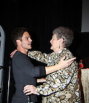 The Young & The Restless star Greg Rikaart hugs Marian who came for her 75th birthday at the Soap Opera Festivals - Meet & Greet wine tasting event on March 24, 2012 at Bally's Atlantic City, Atlantic City, New Jersey.  (Photo by Sue Coflin/Max Photos)