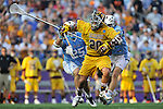 29 MAY 2011: Matt Cannone (20) of Salisbury University holds onto the ball during the game against Tufts University during the Division III Men's Lacrosse Championship held at M+T Bank Stadium in Baltimore, MD.  Salisbury defeated Tufts 19-7 for the national title. Larry French/NCAA Photos