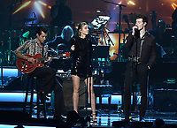 LOS ANGELES, CA - FEBRUARY 8: Mark Ronson, Miley Cyrus, and Shawn Mendes perform on the 2019 MusiCares Person of the Year Tribute Honoring Dolly Parton at the Los Angeles Convention Center on February 8, 2019 in Los Angeles, California. (Photo by Frank Micelotta/PictureGroup)