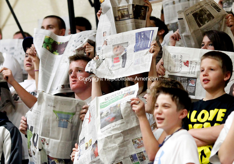 Thomaston, CT-16 December 2011-121611CM07- Thomaston fans use newspapers in an attempt to distract a Gilbert player while shooting free throws Friday night in Thomaston.  Gilbert defeated the Bears 51-47. Christopher Massa Republican-American