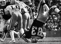 Oakland Raider Ted Hendricks upended against the Green Bay Packers (1976 photo/Ron Riesterer)