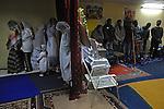 Eritrean asylum-seekers conduct a prayer at their makeshift church in southern Tel Aviv, Israel.